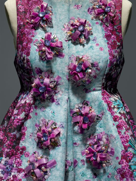 Mary Katrantzou (British, born Athens, 1983). Dress, spring/summer 2014, Prêt–à–Porter. Machine–sewn blue and purple digitally printed polyester satin twill, bonded to neoprene; hand–embroidered with purple Swarovski crystals and pearls, silver acrylic leaves, purple silk velvet ribbon, iridescent plastic sequins, and clear plastic tubing. Photo © Nicholas Alan Cope. #ManusxMachina #CostumeInstitute