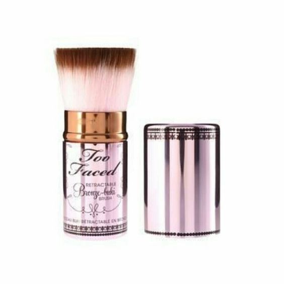 Too Faced Retractable Bronze-buki Brush Brand new, no box. Too Faced Retractable Bronze-buki Brush.  This brush is amazing! It is a big brush and it is perfect for bronzer, the last picture for full description. It is also so soft and feels amazing on your face!! Too Faced Makeup Brushes & Tools