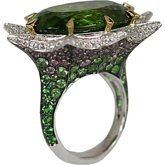 Stephen Webster, Murder She Wrote collection, Angels Trumpet Ring, 18k white gold, peridot (32.78 ct), graduating tsavorites to pale pink sapphires, and white diamonds