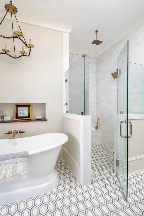 Floor Level Shower With White Gray And Black Geometric Floor Tiles Featuring A Zero Entry Glass Enclosed Wal In 2020 Geometric Floor Glass Shower Doors Walk In Shower