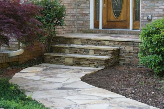 Flagstone walkway leading up to front door steps the step for Front door steps ideas