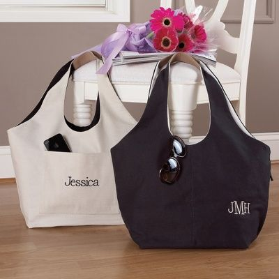 This stylish personalized reversible tote bag from Exclusively Weddings is a practical two-in-one gift for your bridesmaids.