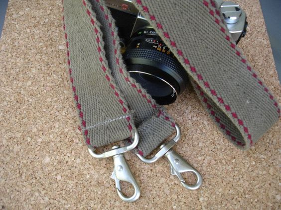 No Rapid strap for me! Gimmie one of these please!:  Vintage Upcycled Camera Strap- Check out our selection of Vintage and Upcycled Camera Straps. $24.99, via Etsy.  ~j.j.
