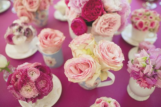 Love the tiny flower arrangements in the miniature teacups, teapots... and the fact that all the flowers are in the pink family - just gorgeous!!!