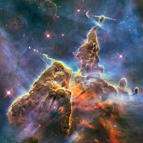 In the Hills, the Cities. | Mystic Mountain Pillar: Towers of cool hydrogen laced with dust rise from the wall of the Carina nebula.