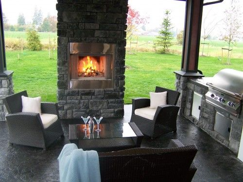 Fireplace at edge of covered patio