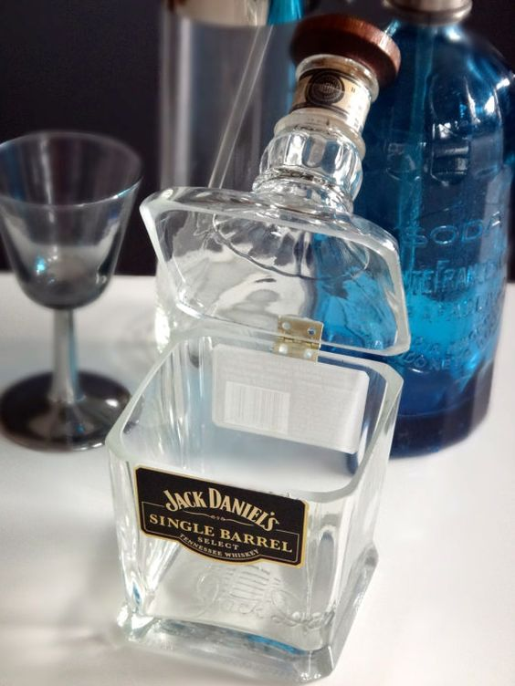 Omg! Hinged glass dish from a liquor bottle - would be so easy to make! It's a goodie jar for the man cave: