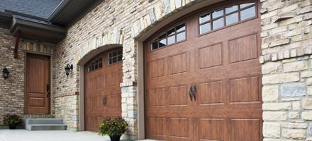 These steel wood grain garage doors definitely add to the for Wood grain garage doors