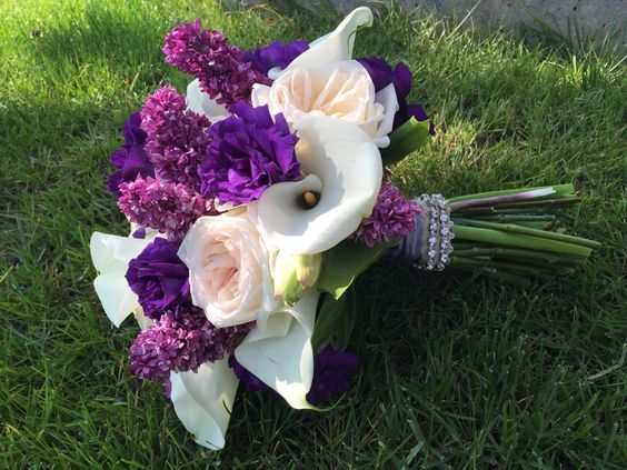 Lilacs, spring bridal bouquet in shades of purples.