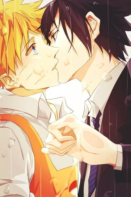 It looks like Sasuke's giving Naruto a quick kiss before he rushes off to work, to me, but it could just be Sasuke wanted a kiss.: