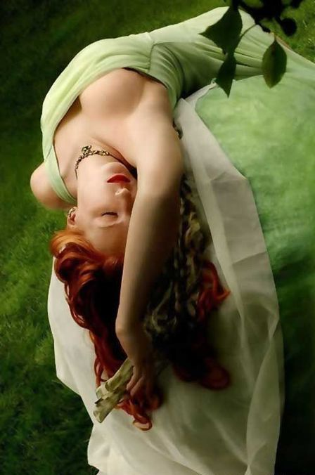 Reclining redhead and lots of green.: