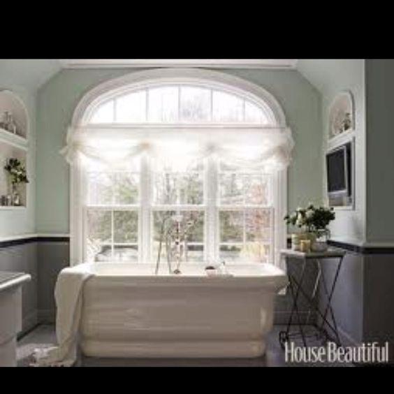 Freestanding bath by window