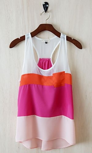 Back In Stock.  This tank combines feminine and playful, high and low style with a nice loose drape perfect for the summer heat or for layering. Dress it up with slim pencil skirt or down with denim.