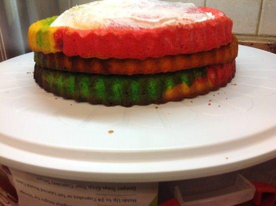 Tie dye cake half iced