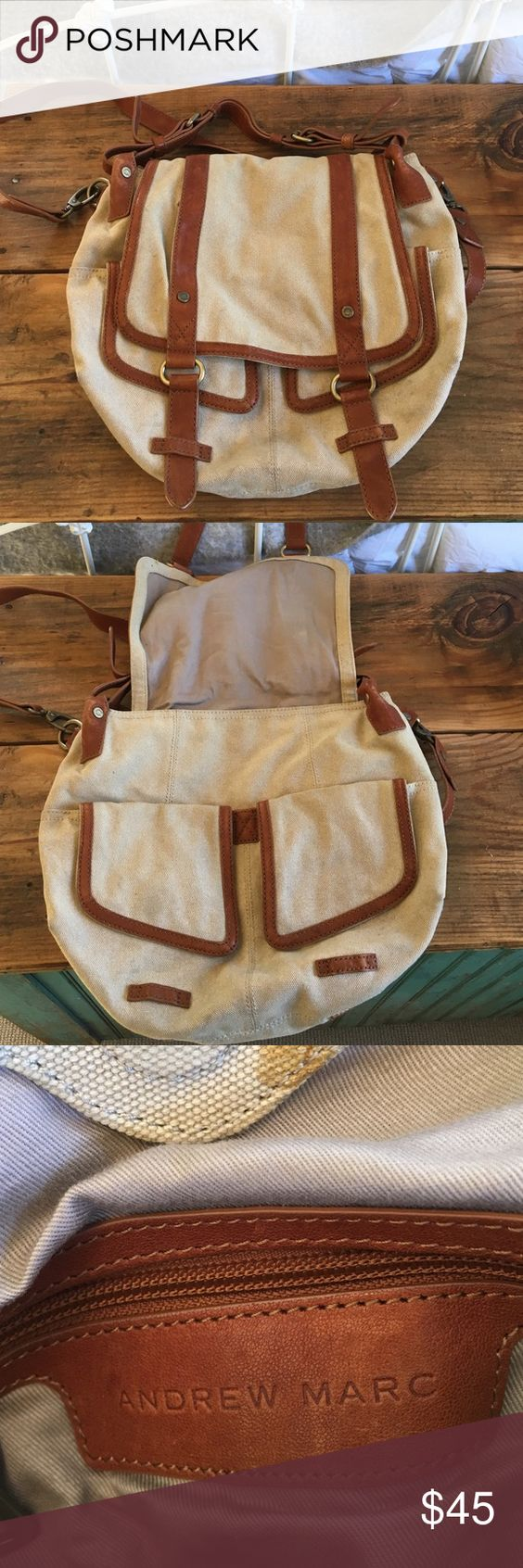 Andrew Marc Canvas Bag Beige/cream colored bag with brown leather. Double pockets in the front with magnet clips. Short and long leather straps. There are a few stains throughout. Feel free to ask questions! Andrew Marc Bags Satchels