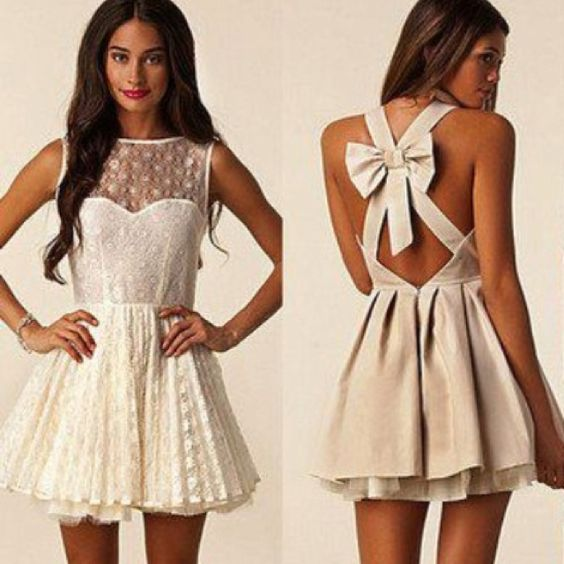 neutral lace dress with bow. adorable!