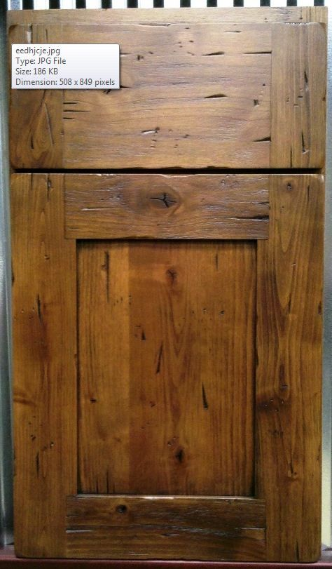 Crystal Cabinet Works - Wire Brushed Knotty Alder - 3pc Slab Drawer Head - Door Rails Extend into the Stiles - Black Highlight.