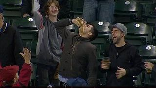 Mariners fan catches ball in beer cup, then chugs