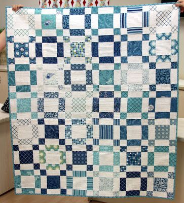 "Christa's Quilts:Sea of Squares, 51"" x 58"" by Christa Watson...Sea of Squares is a simple-to-piece quilt made entirely from charm packs. The bold design is enhanced with (mostly) straight line quilting, done entirely with a walking foot."
