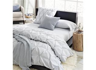 DIY pin tucked duvet cover from sheets.. looks simple & classy!