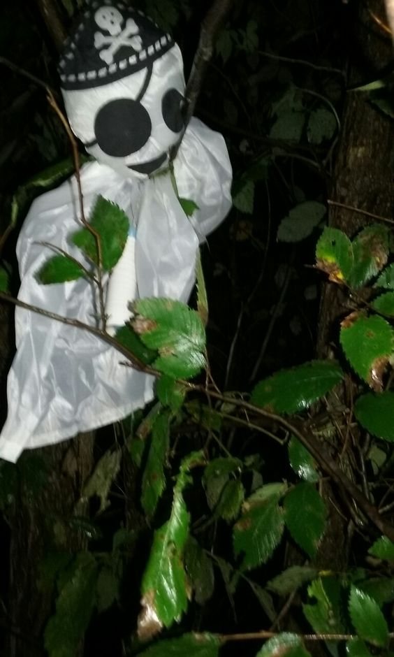 attached this nylon ghost to a tree, made the cache container white w/tape, put in cemetery.
