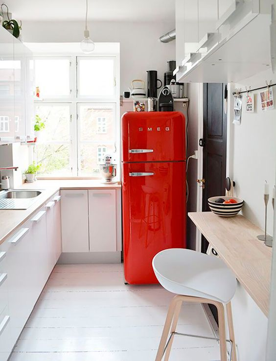 Red Smeg White Minimal Kitchen with a Touch of Retro thrown in!: