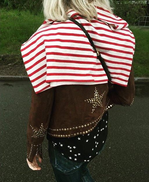 Red and white striped shirt, star print silk top, brown suede jacket, and jeans