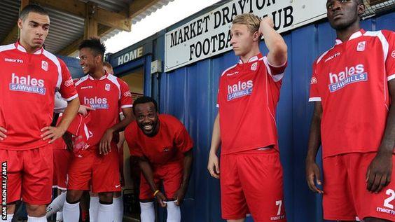 Former France defender Pascal Chimbonda [third right] makes an appearance for Market Drayton