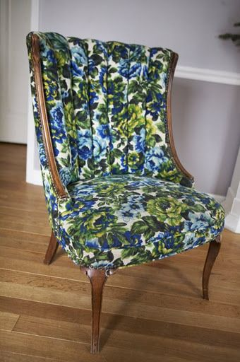 I think this chair is rockin' a floral print, probably reupholstered in the 1960s. Looking good!