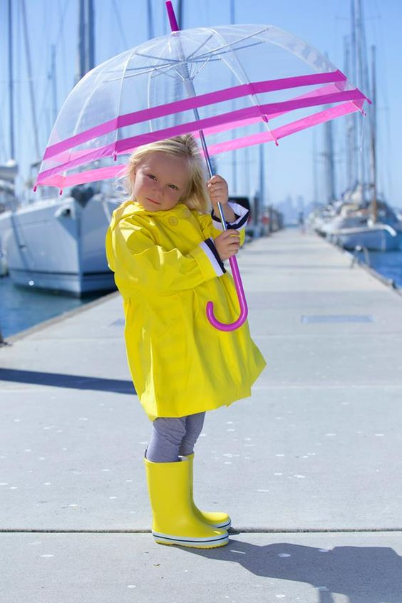 Delightful kids umbrella by Australian designer kids range, French Soda! This clear umbrella features a pop of pink with striped detailing and an easy push button - perfect for little hands to open and close.  Pair with a pair of fun, wellington gumboots and a kids raincoat and your little one is ready for a day of puddle jumping and rainy adventures!