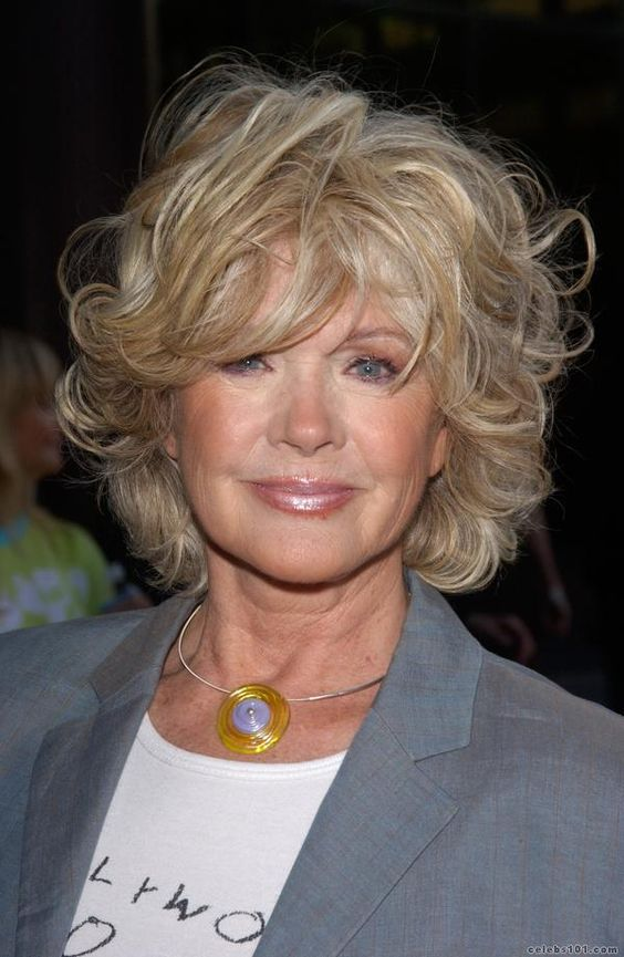 Connie Stevens. Soft wavy layers compliment a mature woman as does the colour. Keeping your lips a light'ish shade is also more flattering.