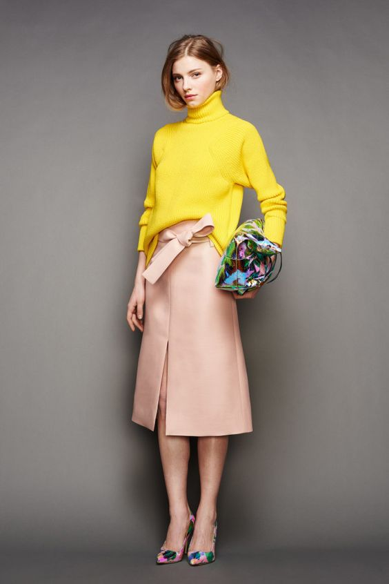 Yellow turtleneck sweater and pink split-front skirt for fall: