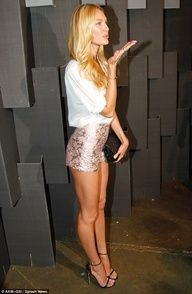 Sealed with a kiss: Candice Swanepoel attends a private event as she visits Brazil for Sao Paulo Fashion Week