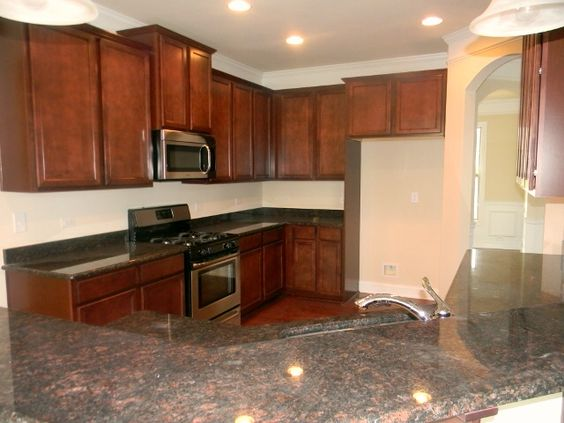 Maple cabinets brown and floor plans on pinterest for Avalon kitchen cabinets