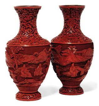 A PAIR OF CHINESE CINNABAR LACQUER VASES  CIRCA 1900. Each carved to the body with scholars and attendants amongst a mountainous landscape, the neck with lotus scrolls