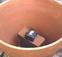 Creating a fountain out of a terracotta pot... pretty awesome.