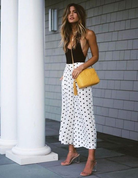 The alluring bodysuit and wide leg polka dot pants were made to be worn anywhere & everywhere! | We're Going Completely Dotty Over These Chic Summer Outfits