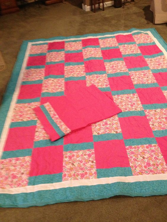 Teal, pink and white quilt