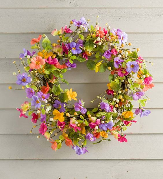 Hang this Floral Watercolor Wreath on your front door as a sunny welcome to visitors. Faux flowers on a twig base brighten any space with an array of colorful pansies and violets. Shades of pink, purple and yellow add a cheerful touch to any door or wall. Use indoors or outside in a protected area; for longest life, do not expose directly to the elements.