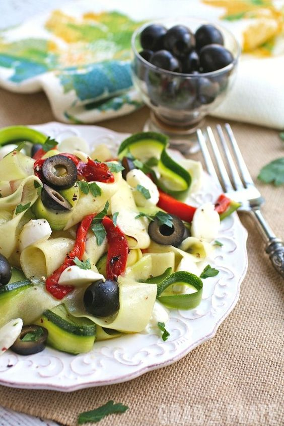 """Dig into a Mediterranean-inspired, seasonal meal: Chilled Zucchini Ribbon """"Pasta"""" with Black Olives, Roasted Red Peppers and Mozzarella"""