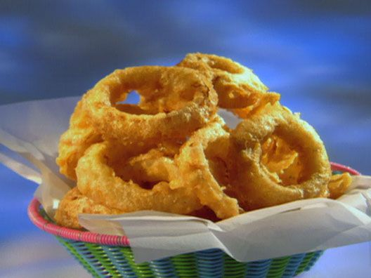 Food Network invites you to try this Beer Battered Onion Rings recipe from Guy Fieri.