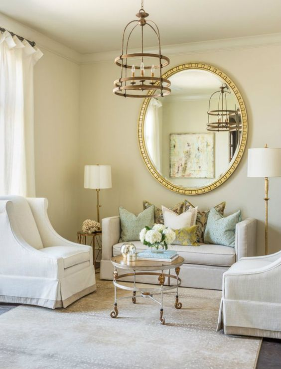 Large round wall mirror in white living room with gold accents. Beautiful Classically Refined Rooms