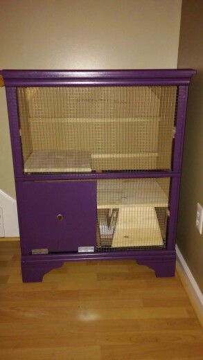 Old dresser repurposed with chicken wire into a bunny for Rabbit cage made out of dresser