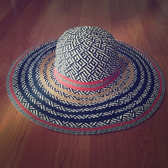 Super cute Aldo straw hat Perfect for those sunny days at the beach! Very cool Aldo straw hat, a nice change from your ordinary straw hat it has funky colors and is in very good shape ALDO Accessories Hats