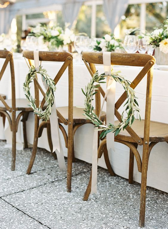 Bay leaf wreaths, chair décor, sweetheart chairs, white ribbons, wooden cross back chairs // Virgil Bunao Photography