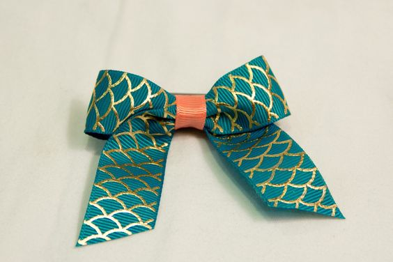 A personal favorite from my Etsy shop https://www.etsy.com/listing/230693584/aqua-mermaid-tail-hair-bow