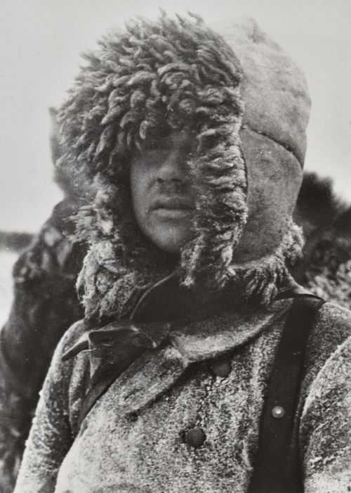 A German soldier wearing winter garment and a bearskin hat in the vicinity of Rostov-on-Don, winter of 1942-43 — a photograph that amply conveys the temperatures soldiers had to endure during the winter season on the Eastern Front.