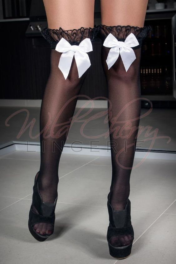 Black and White Bow Stockings Sku Number: S_2033B Ultimately sexy, these stockings are also sweet in a flirty way. With a large ruffle on the top and a white stain bow to offset the black, these are delightfully sweet and sexy stockings that are sure to please. Wear these under a longer dress and then surprise your partner when you disrobe. Even better? Wear these with nothing other than a sexy piece of lingerie; their versatile nature will accent all lingerie styles perfectly.
