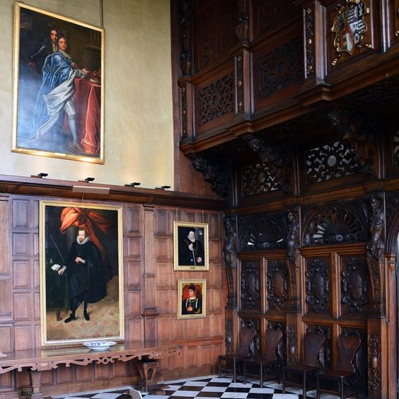 The Marble Hall with a large portrait of Robert Cecil, 1st Earl of Salisbury (1563-1612) bottom left: