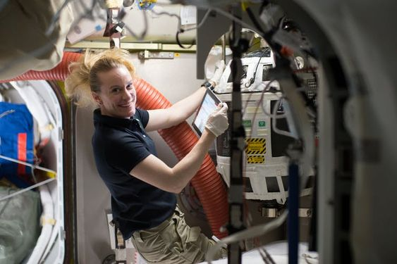 NASA astronaut Kate Rubins works with a Nitrogen/Oxygen Recharge System tank aboard the International Space Station. The tanks are designed to be plugged into the station's existing air supply network to refill the crew's breathable air supply. NASA